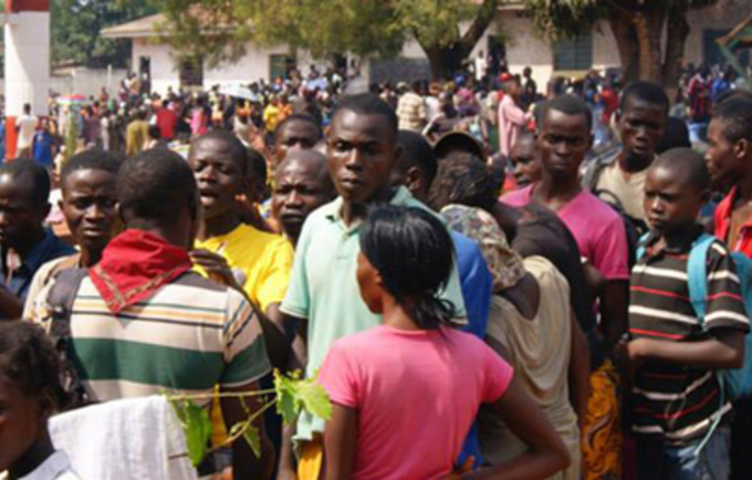 Young people line up at the Don Bosco Youth Centre in Bangui, one the sites where thousands of people have taken refuge from the latest surge in sectarian violence ravaging Central African Republic. UNFPA has deployed emergency assistance to displaced women and youth affected by the fighting, delivering dignity and safe birth kits, as well as life-saving supplies. Photo © UNFPA CAR